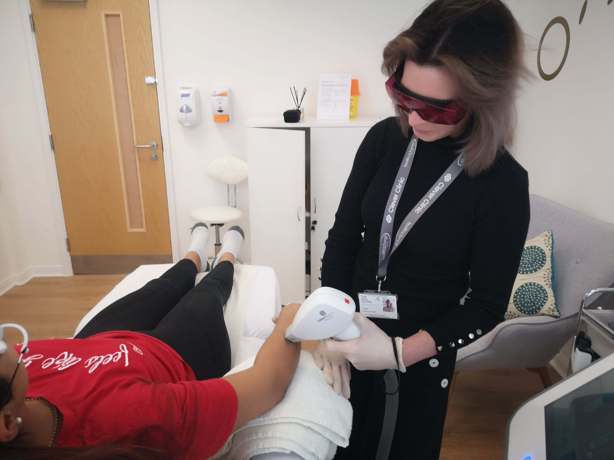 Lorna treating client arm with laser hair removal